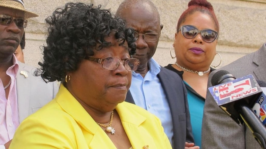 Judy Scott, the mother of Walter Scott who was shot and killed while fleeing a traffic stop in April of 2015, speaks to reporters outside the federal courthouse in Charleston, S.C., on Wednesday, May 11, 2016. Prosecutors on Wednesday unsealed an indictment charging white former police officer Michael Slager with three federal counts in the death of Scott. Slager already faces a murder charge in state court. (AP Photo/Bruce Smith)