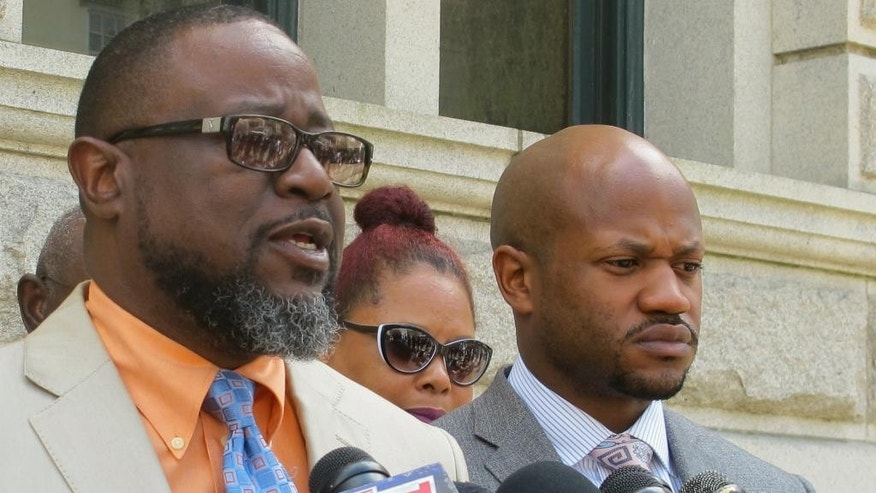 Anthony Scott, the brother of Walter Scott who was shot and killed while fleeing a traffic stop in April, 2015, speaks to reporters outside the federal courthouse in Charleston, S.C., Wednesday, May 11, 2016. At right is the Scott family attorney Chris Stewart. Prosecutors on Wednesday unsealed a federal indictment charging white, former police officer Michael Slager with three federal counts in the death of Scott. Slager already faces a murder charge in state court. (AP Photo/Bruce Smith)