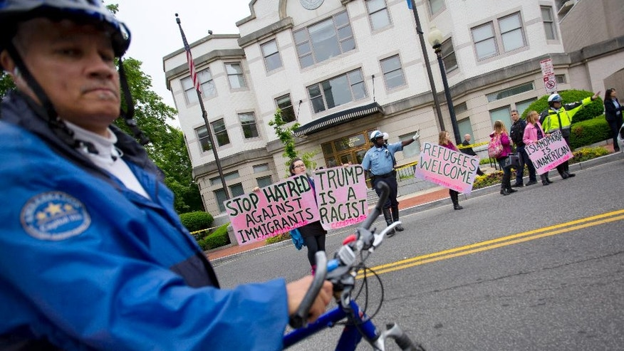 Members of CodePink are escorted by law enforcement officer across the street after the arrival of Republican presidential candidate Donald Trump at the National Republican Senatorial Committee (NRSC) building in Washington, Thursday, May 12, 2016. Trump is scheduled to meet with Senate Majority Leader Mitch McConnell of Ky., and other Senate GOP leadership. (AP Photo/Pablo Martinez Monsivais)