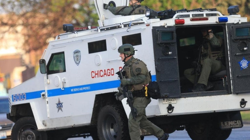 Members of the Chicago Police Department work the scene.