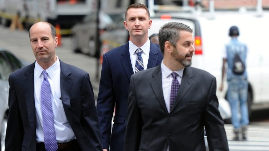 FILE - In this May 10, 2016, file photo, from left, attorney Marc Zayon, Baltimore Police Officer Edward Nero and attorney Jason Silverstein, walk to Courthouse East before a hearing in Baltimore. The trial for Nero, one of the officers charged in the arrest and death of Freddie Gray, will begin Thursday, May 12. (Kim Hairston/The Baltimore Sun via AP, File)  WASHINGTON EXAMINER OUT; MANDATORY CREDIT