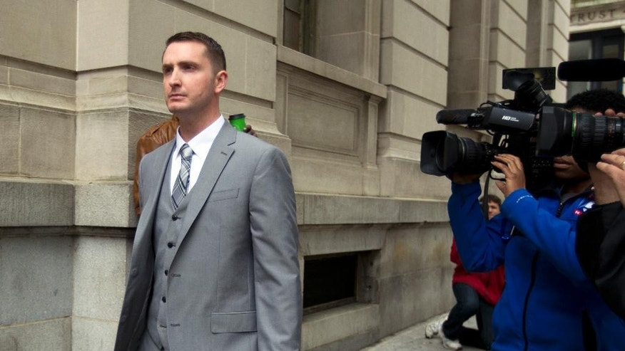 Officer Edward Nero, one of six Baltimore city police officers charged in connection to the death of Freddie Gray, arrives at a courthouse at the beginning of his trial, Thursday, May 12, 2016, in Baltimore Md. Nero faces assault, misconduct in office and reckless endangerment charges. (AP Photo/Jose Luis Magana)