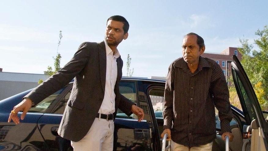 FILE - In this Sept. 1, 2015 file photo, Chirag Patel, left, helps his father, Sureshbhai Patel, out of the car as they arrive outside the federal courthouse before start of a trial against Madison, Ala., police Officer Eric Sloan Parker, in Huntsville, Ala. A judge has dismissed state charges against Parker who was accused of assaulting Sureshbhai Patel during a suspicious person investigation. Limestone County District Judge Douglas Patterson dismissed the case against Parker on Thursday, May 12, 2016. Parker was recorded slamming Sureshbhai Patel to the ground in February 2015.  (AP Photo/Brynn Anderson, File)