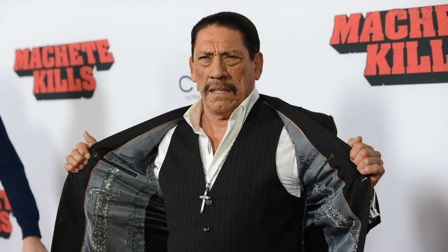 "FILE - In this Oct. 2, 2013, file photo, actor Danny Trejo arrives at the premiere of ""Machete Kills"" at Regal Cinemas L.A. Live in Los Angeles. The Los Angeles Times reports Trejo took the floor at a community meeting at Sylmar High School in Los Angeles on May 11, 2016, following a brawl at the school. (Photo by Jordan Strauss/Invision/AP, File)"