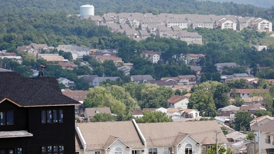 FILE - In this July 1, 2014, file photo, a new housing unit, left, is under construction in Kiryas Joel, N.Y.  Agents with the FBI and other law enforcement agencies have seized documents from the Hasidic village on May 12, 2016, as part of an ongoing investigation. (AP Photo/Mike Groll, File)