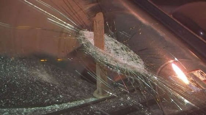 Photo shows spike going through windshield.