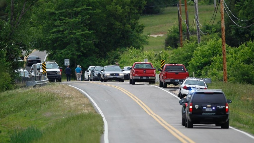 Emergency vehicles patrol Colonial Estates Road, north of the runway at the Tupelo Regional Airport in Tupelo, Miss., Monday morning, May 16, 2016, following an airplane crash. The pilot and three passengers all died when the single-engine plane crashed in a field adjoining the Tupelo Buffalo Park & Zoo. (Thomas Wells/The Northeast Mississippi Daily Journal via AP) MANDATORY CREDIT
