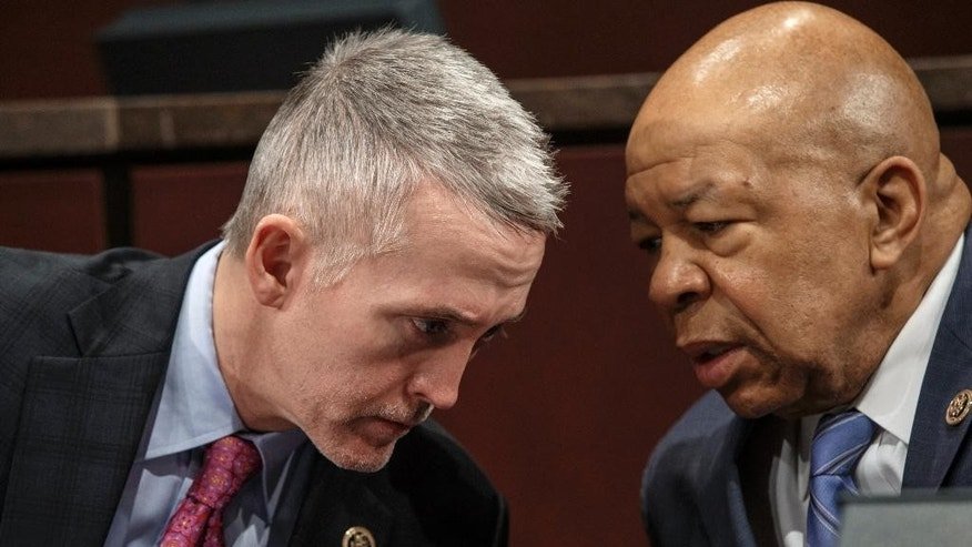 FILE - In this Jan. 27, 2015 file photo, House Benghazi Committee Chairman Rep. Trey Gowdy, R-S.C., left, confers with the committee's ranking member Rep. Elijah Cummings, D-Md., during the committee's hearing on Capitol Hill in Washington.  Democrats on the House Benghazi panel are insisting that the military did what it could in response to the deadly twin attacks on Sept. 11, 2012, in Libya despite lingering questions about whether U.S. forces could have gotten to there in time to save lives. (AP Photo/J. Scott Applewhite, File)