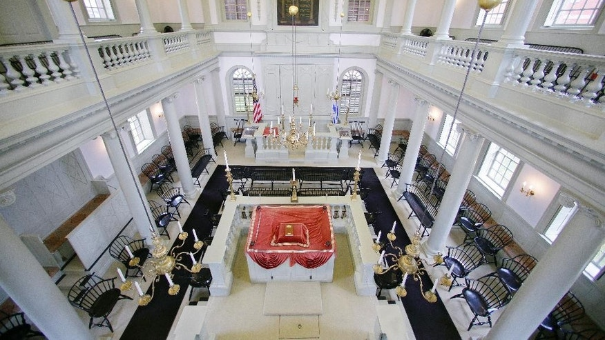 """FILE - In this Thursday, May 28, 2015 file photo, an interior view of the Touro Synagogue, the nation's oldest, is seen from the """"ladies gallery"""" in Newport, R.I. A federal judge on Monday, May 16, 2016, awarded control of Touro and a pair of ceremonial bells valued at more than $7 million to the congregation that worships there. A lawsuit pitted the congregants against the nation's oldest Jewish congregation in New York City which became trustee of Touro in the 1820s after Jews left, Newport. (AP Photo/Stephan Savoia, File)"""