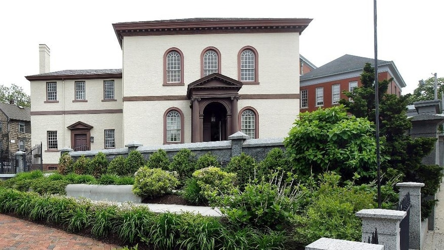 FILE - In this Thursday, May 28, 2015 file photo, the Touro Synagogue, the nation's oldest, stands in Newport, R.I. A federal judge on Monday, May 16, 2016, awarded control of Touro and a pair of ceremonial bells valued at more than $7 million to the congregation that worships there. A lawsuit pitted the congregants against the nation's oldest Jewish congregation in New York City which became trustee of Touro in the 1820s after Jews left, Newport. (AP Photo/Stephan Savoia, File)