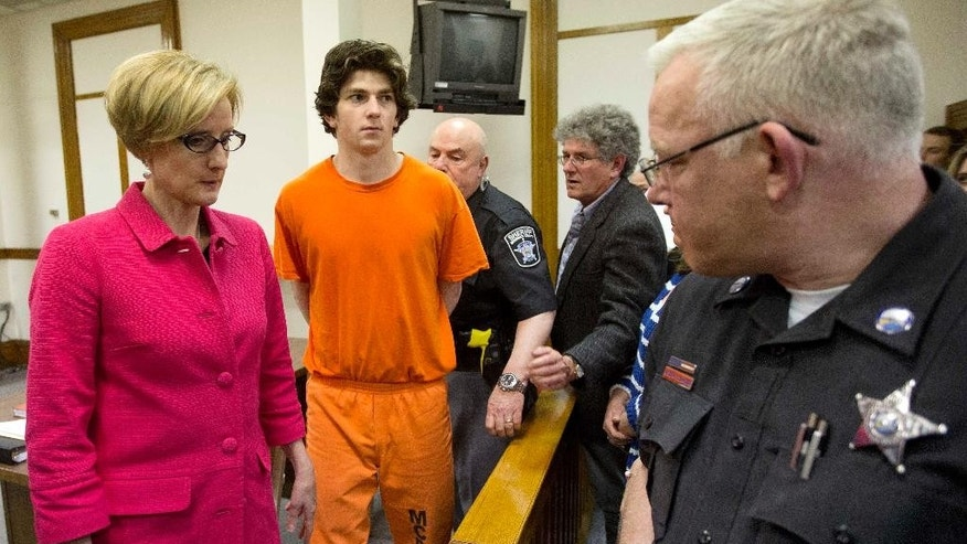 Owen Labrie is escorted out of the Merrimack County Superior Courtroom Monday, May 16, 2016, in Concord, N.H. after a judge agreed to new bail conditions. Labrie, a prep school graduate convicted of sexually assaulting a 15-year-old freshman girl as part of a game of sexual conquest called Senior Salute, will again be free pending appeal and now required to use electronic monitoring via GPS.(AP Photo/Jim Cole, Pool)