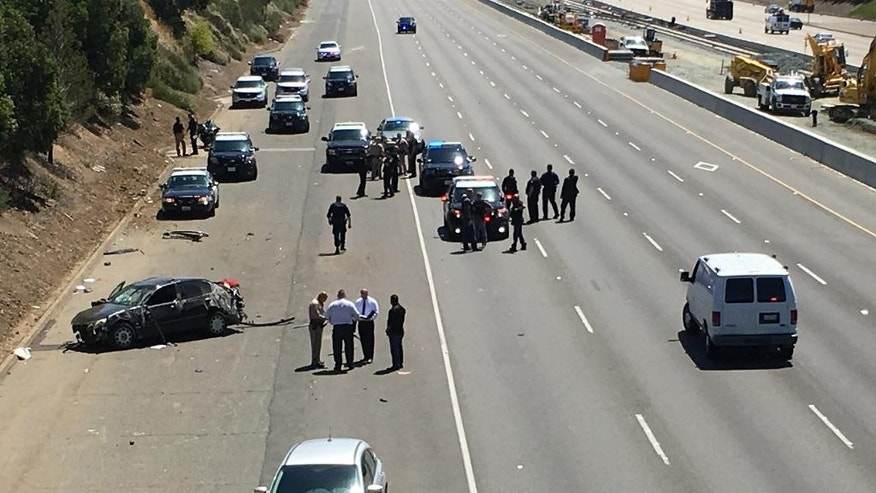 In a May 11, 2016 photo, Westbound Highway 4 in Pittsburg, Calif., is closed as police investigate a shooting. Northern California authorities are grappling with more than 20 drive-by shootings on two area freeways that have claimed six lives and injured several more. The California Highway Patrol and several police departments have created a task force to stem the roadway violence and at least one city will install security cameras to capture the shooters. (Kristopher Skinner/Bay Area News Group via AP)