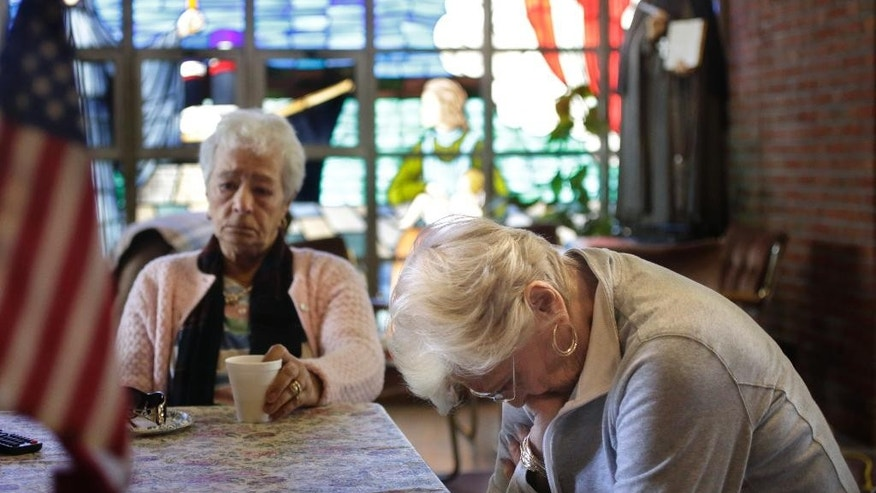 In this Monday, May 16, 2016 photo ,Mary Fernandes, left, and Nancy Shilts, right, parishioners at St. Frances X. Cabrini church are emotional while talking about the closing of the church, in Scituate, Mass. Now that the U.S. Supreme Court has refused to hear their last-ditch appeal, parishioners who have occupied the Roman Catholic church for 11 years in defiance of the Boston archdiocese's order to close it are vowing to create an independent church outside the Vatican's control. (AP Photo/Steven Senne)