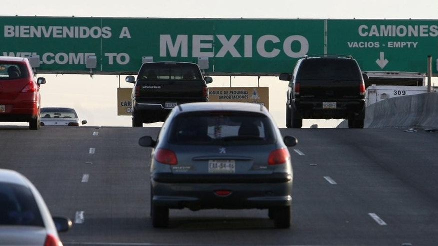 FILE - This Jan. 17, 2008 file photo, South bound vehicles leave El Paso, Texas and enter Juarez, Mexico at the Bridge of the Americas international port of entry. Immigrant advocates are complaining about U.S. Customs and Border Protection officers' actions toward residents along the U.S.-Mexico border in El Paso and New Mexico. A coalition of advocacy groups said Tuesday, May 17, 2016, that they filed a complaint with the U.S. Department of Homeland Security alleging at least 13 residents have experienced abuse, including being falsely accused of being prostitutes to having legal document seized for no reason. (Rudy Gutierrez/El Paso Times via AP, File) OUT EL PASO, EL DIARIO OUT, JUAREZ, MEXICO, EL DIARIO DE EL PASO OUT