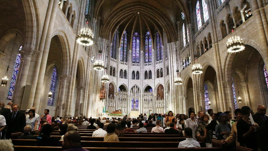 "FILE- This July 20, 2014, file photo shows the vaulted ceiling inside New York's Riverside Church. It is one of the religious institutions across New York state showcasing their art, architecture and history during the New York Landmark Conservancy's annual ""Sacred Sites Open House Weekend"" from May 21-22, 2016. (AP Photo/Kathy Willens, File)"