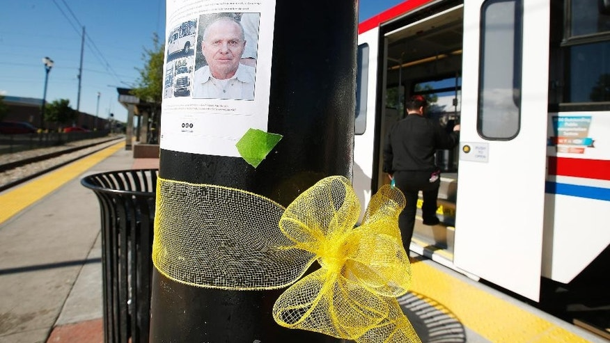 Yellow ribbons and photos of Utah Transit Authority employee Kay Ricks line the UTA Trax Ballpark station in Salt Lake City, Wednesday, May 18, 2016. Law enforcement officials are looking for a possible connection between a missing Utah Transit Authority worker, whose body was discovered late Tuesday evening, and the Centerville, Utah, kidnapping suspects arrested over the weekend.  (Jeffrey D. Allred/The Deseret News via AP)  SALT LAKE TRIBUNE OUT; MAGS OUT; MANDATORY CREDIT; TV OUT