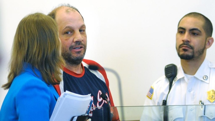 Richard Simone, center, confers with attorney Laurel A. Singer during his arraignment Wednesday, May 18, 2016, in Worcester, Mass. Simone, charged with leading police on a 50-mile car chase from Massachusetts to New Hampshire that ended with officers punching him, was ordered held held without bail on a parole violation and $50,000 cash bail on the new charges. (Christine Peterson/Worcester Telegram & Gazette via AP) MANDATORY CREDIT