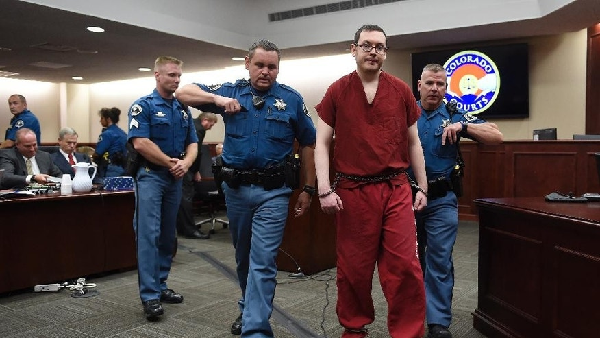FILE - In this Aug. 26, 2015 file photo, Colorado theater shooter James Holmes is led out of the courtroom after being formally sentenced in Centennial, Colo. A jury decided Thursday, May 19, 2016 that the owner of the Colorado movie theater could not have prevented a 2012 shooting rampage by Holmes that killed 12 people, despite arguments by victims that lax security allowed for the attack. The six jurors concluded that Cinemark was not liable for the attack, siding with the nation's third-largest theater chain in a civil case closely watched by the country's major theater companies. (RJ Sangosti/The Denver Post via AP, Pool, file)