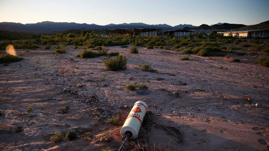 A buoy lies high and dry above the water line at the now defunct Echo Bay Marina in the Lake Mead National Recreation Area, Thursday, May 19, 2016, near Las Vegas. Lake Mead's surface was at its lowest level Wednesday since the reservoir was created. (AP Photo/John Locher)