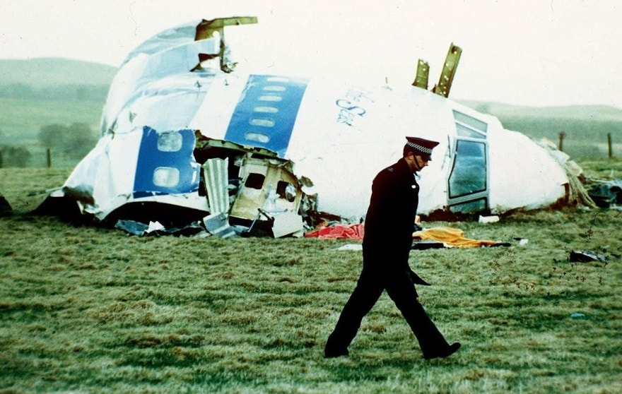 "FILE - In this Wednesday, Dec. 21, 1988 file photo, a police officer walks by the nose of Pan Am flight 103 in a field near the town of Lockerbie, Scotland where it lay after a bomb aboard exploded, killing a total of 270 people. Scottish prosecutors said Thursday, Oct. 15, 2015 they have identified two Libyans as suspects in the 1988 bombing of a passenger jet over the town of Lockerbie, and want to interview them in Tripoli. Scotland's Crown office said that Lord Advocate Frank Mulholland and U.S. Attorney General Loretta Lynch had agreed ""that there is a proper basis in law in Scotland and the United States to entitle Scottish and U.S. investigators to treat two Libyans as suspects in the continuing investigation into the bombing of flight Pan Am 103."" The unnamed Libyans are suspected of involvement with Abdel Baset al-Megrahi, the only person convicted in the attack. (AP Photo/Martin Cleaver, File)"