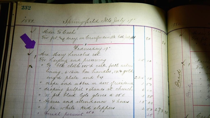 """This May 18, 2016, photo shows an itemized list of expenses believed to be from the 1882 funeral of Mary Todd Lincoln at the Boardman-Smith Funeral Home in Springfield, Ill. The list was included in stacks of fragile ledgers acquired by Butler Funeral Homes of Springfield through the buyout last year of Boardman-Smith Funeral Home. Butler Funeral Homes is creating a """"Lincoln Room"""" where the Mary Lincoln Todd ledger entry will be displayed with other documents tied to Springfield's funeral history. (Rich Saal/The State Journal-Register via AP) MANDATORY CREDIT"""