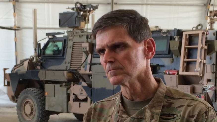 Army Gen. Joseph Votel speaks to reporters at a base in Taji, Iraq, Friday, May 20, 2016, where Iraqi soldiers are being trained by Australian and New Zealand military forces. Bolstered by U.S. airstrikes, Iraqi ground forces have recaptured the western town of Rutba after Islamic State fighters who had occupied the town for nearly two years fled or put up only light resistance, U.S. military officers said Friday, May 20, 2016. (AP Photo/Robert Burns)
