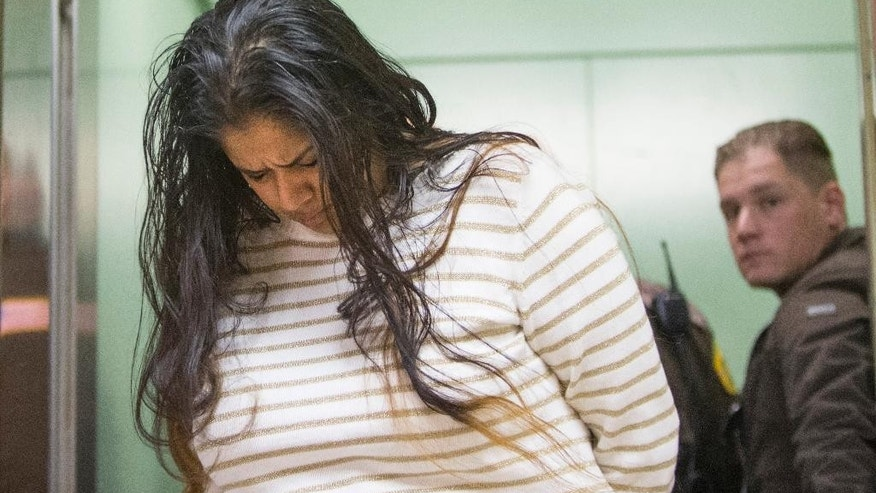 FILE - In this March 30, 2015 file photo, Purvi Patel is taken into custody after being sentenced to 20 years in prison for feticide and neglect of a dependent on at the St. Joseph County Courthouse in South Bend, Ind. Attorneys for Patel will urge the Indiana Court of Appeals on Monday, May 23, 2016 to reverse her 2015 convictions on charges of feticide and neglect of a dependent resulting in death. The state's attorney general's office will defend the northern Indiana jury's decision. (Robert Franklin/South Bend Tribune via AP) MANDATORY CREDIT