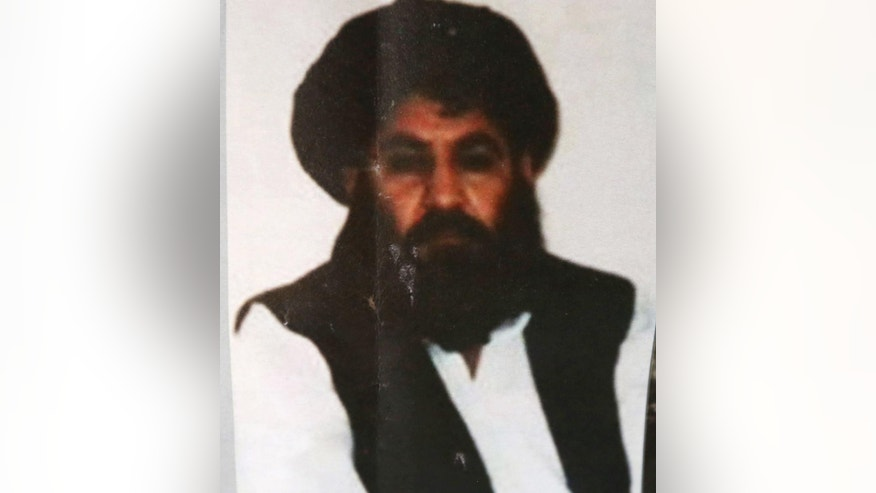 FILE - In this Saturday, Aug. 1, 2015 file photo, shows Taliban leader Mullah Mansour.  The U.S. conducted an airstrike Saturday, May 21, 2016, against the Taliban leader the Pentagon said, and a U.S. official said Mansour was believed to have been killed. Pentagon press secretary Peter Cook said the attack occurred in a remote region along the Afghanistan-Pakistan border. He said the U.S. was studying the results of the attack.  (AP Photo/Rahmat Gul, File)