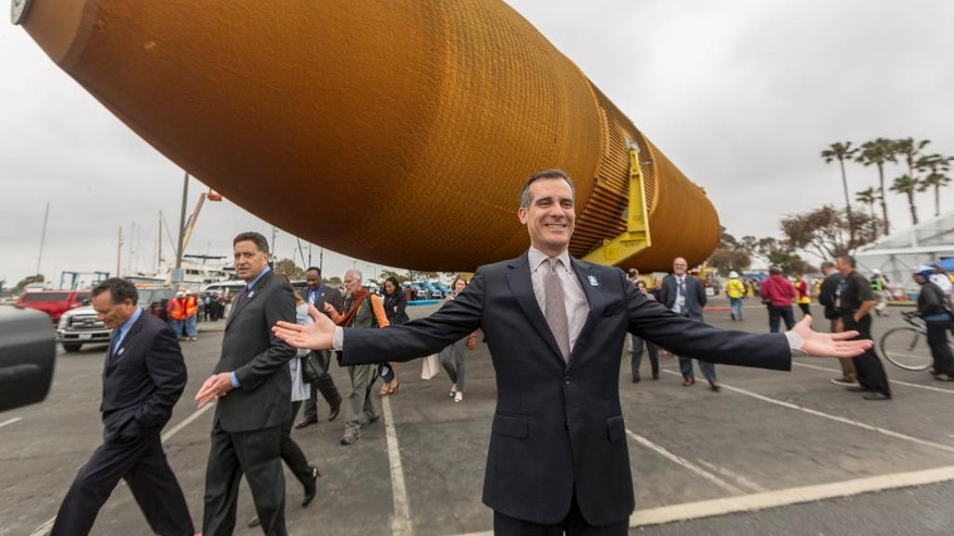 Los Angeles Mayor Eric Garcetti, welcomes the external propellant tank ET- 94 after being unloaded from a barge at the Marina del Rey, Calif., on Wednesday, May 18, 2016. NASA's only remaining version of the tank will be placed on dollies and pulled by a truck to its final destination near the California Science Center's Samuel Oschin Pavilion in Los Angeles. (AP Photo/Damian Dovarganes)