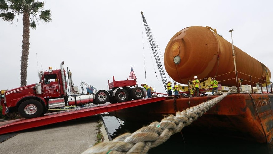 The external Tank, ET- 94, NASA's only remaining space shuttle external tank is unloaded from a barge at the Marina del Rey, Calif., on Wednesday, May 18, 2016. The ET-94 will be placed on dollies and pulled by a truck to its final destination near the California Science Center's Samuel Oschin Pavilion in Los Angeles. (AP Photo/Damian Dovarganes)