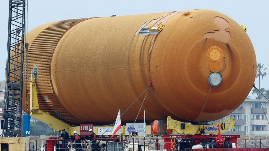 The space shuttle external propellant tank ET- 94, arrives aboard a barge at Marina del Rey, Calif., on Wednesday, May 18, 2016. NASA's only remaining version of the tank will be placed on dollies and pulled by a truck to its final destination near the California Science Center's Samuel Oschin Pavilion in Los Angeles. (AP Photo/Damian Dovarganes)