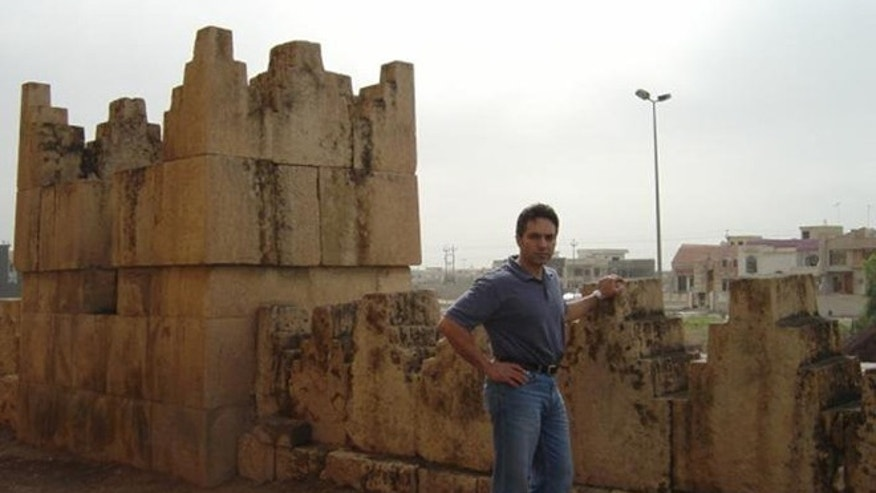 DeKelaita, shown here in his homeland of Iraq, claims he ran afoul of the Departmennt of Justice when he complained about the treatment of Christian asylum seekers.