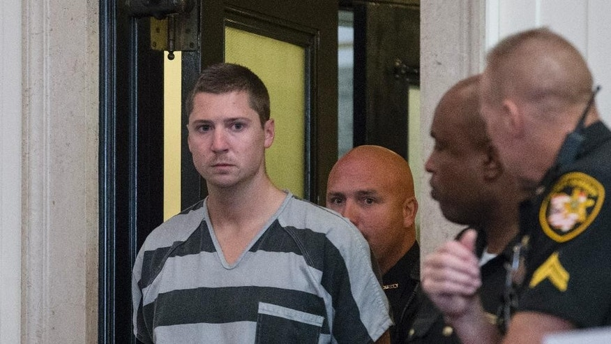 "FILE - In this July 30, 2015, file photo, former University of Cincinnati police officer Ray Tensing appears for his arraignment in the July 19, 2015, shooting death of motorist Samuel DuBose at the Hamilton County Courthouse in Cincinnati. Hamilton County Probate Judge Ralph ""Ted"" Winkler ordered Monday, May 23, 2016, that DuBose's 13 children will each receive nearly $218,000 as part of a $4.9 million wrongful death settlement reached in January. (AP Photo/John Minchillo, File)"