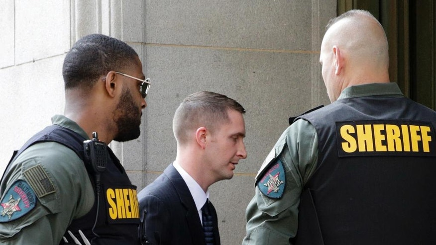 Officer Edward Nero, center, one of six Baltimore city police officers charged in connection to the death of Freddie Gray, arrives at a courthouse to receive a verdict in his trial in Baltimore, Monday, May 23, 2016. (AP Photo/Patrick Semansky)