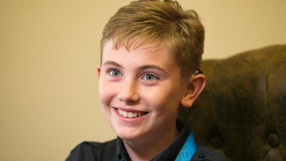 Neil Maes, 11, of Belton, S.C., smiles while he is interviewed at The Alexander Graham Bell Association for the Deaf and Hard of Hearing (AG Bell) in Washington, Tuesday, May 24, 2016. Maes was born deaf and now hears with the helps of cochlear implants. The boy will participate in his first National Spelling Bee Wednesday, May 25, 2016. (AP Photo/Jacquelyn Martin)