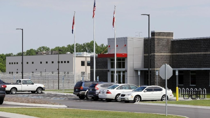Trousdale Turner Correctional Center is shown Tuesday, May 24, 2016, in Hartsville, Tenn. Tennessee's newest prison has had to halt new admissions after just four months of full operation. A memorandum from a state prison official about the privately run facility says guards there do not have control of the housing units, aren't counting inmates correctly, and are sending them to solitary confinement for no documented reason. (AP Photo/Mark Humphrey)
