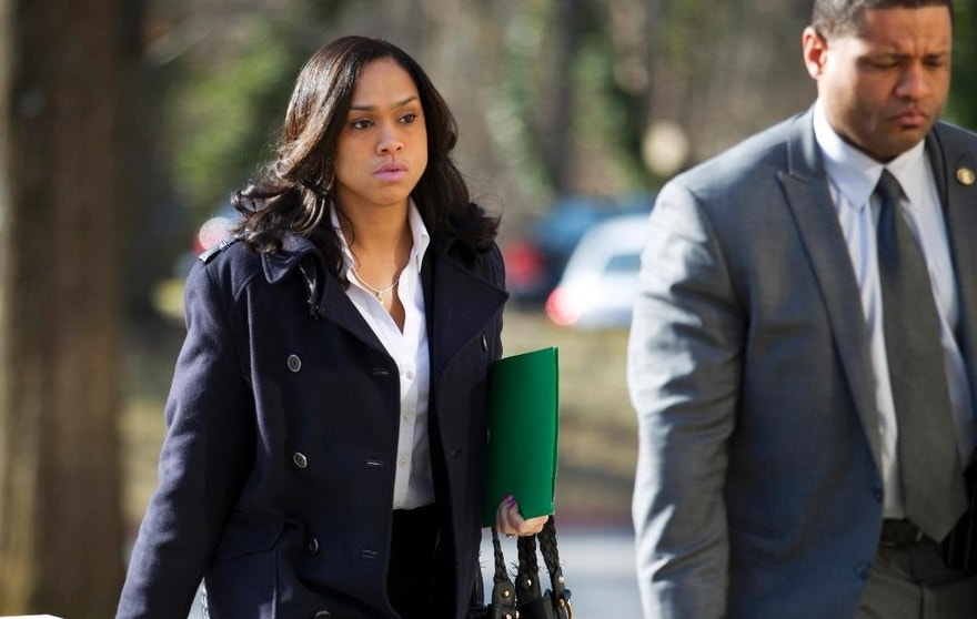 FILE - In this March 3, 2016 file photo, Baltimore State's Attorney Marilyn Mosby, left, arrives at Maryland Court of Appeals in Annapolis, Md. The Baltimore's top prosecutor is facing criticism that she moved too quickly to file charges against six officers in the death of Freddie Gray without first ensuring there was enough evidence to bring them to bear. A judge on Monday, May 23, acquitted Officer Edward Nero of the assault, misconduct in office and reckless endangerment charges in the April 2015 arrest of the African-American man. Legal experts say the acquittal in the racially charged case could be seen by some as a confirmation of criticism that Mosby rushed to file charges. (AP Photo/Jose Luis Magana, File)