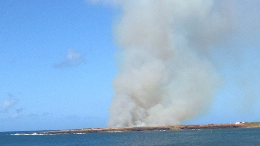 Plumes of smoke seen from Port Allen Harbor.