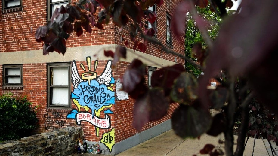 A mural is seen at the site of Freddie Gray's arrest in the Sandtown neighborhood of Baltimore, Monday, May 23, 2016, after Officer Edward Nero, one of six Baltimore city police officers charged in connection to the death of Gray, was acquitted of all charges in his trial. (AP Photo/Patrick Semansky)