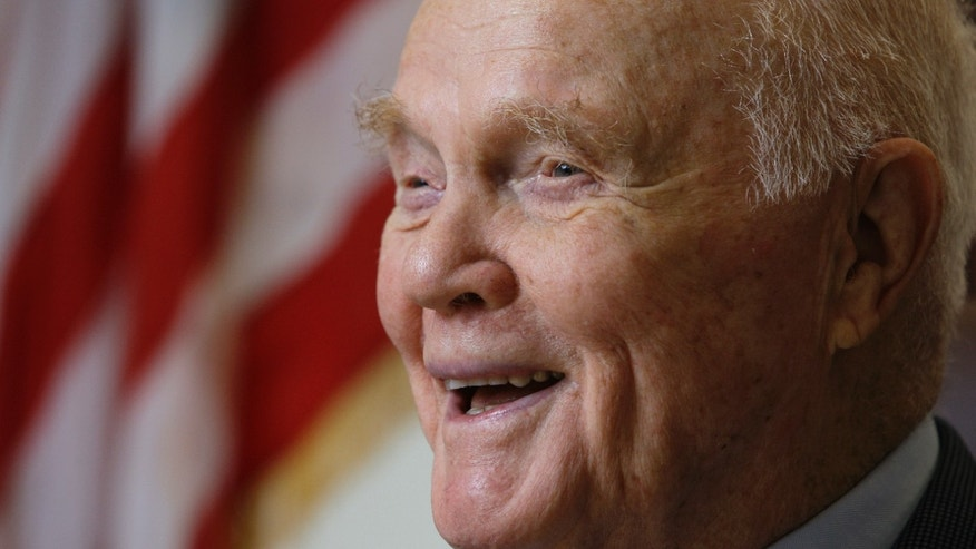 In this Jan. 25, 2012 photo, Sen. John Glenn speaks during an interview at his office in Columbus, Ohio. Glenn was the first American to orbit Earth, piloting Friendship 7 around the planet three times in 1962. Glenn, as a U.S. senator at age 77, also became the oldest person in space by orbiting Earth with six astronauts aboard shuttle Discovery in 1998. (AP Photo/Jay LaPrete)