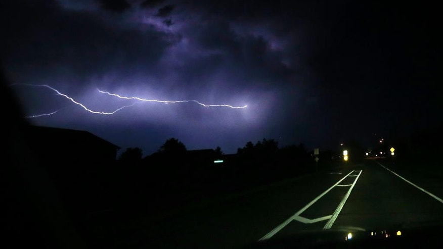 Lightning strikes cloud-to-cloud along a county road near Lawrence, Kan., Thursday, May 26, 2016. Severe storms that produced at least one tornado moved through the area overnight. (AP Photo/Orlin Wagner)