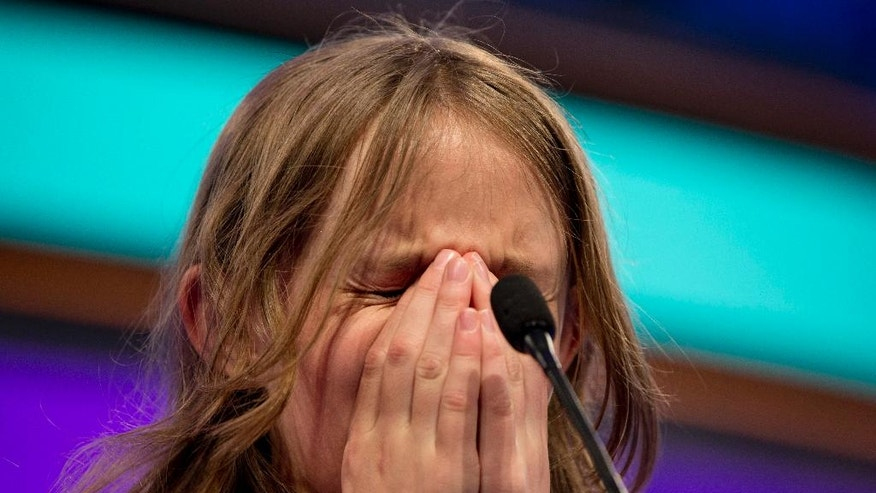 Sylvie Lamontagne, 13, of Lakewood, Colo., focuses to spell a word correctly during the finals of the 2016 National Spelling Bee, in National Harbor, Md., on Thursday, May 26, 2016. (AP Photo/Jacquelyn Martin)