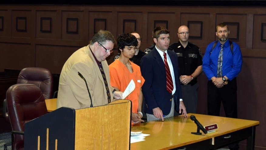 Anthony R. Arriaga, second left,  is arraigned Thursday, May 26, 2016, in Mingo County Circuit Court before Judge Miki Thompson, in Williamson, WV. Arriaga is one of three people charged in the shooting death of ex-coal chief executive Bennett Hatfield. He was ordered held without bond pending a preliminary hearing June 3. Authorities say Hatfield was visiting his wife's gravesite at the Mountain View Memory Gardens in southern West Virginia when he was fatally shot. His body was found at the cemetery Monday. (Kyle Lovern/Williamson Daily News via AP)