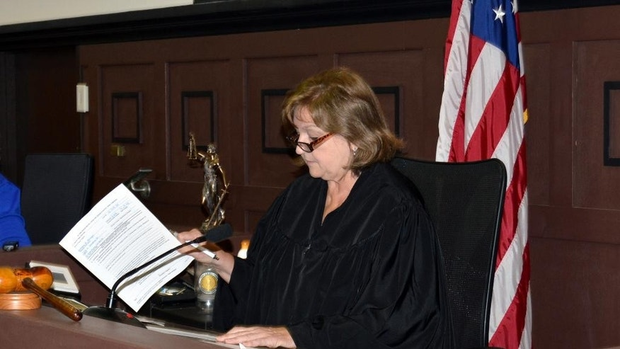 Judge Miki Thompson presides in Mingo County Circuit Court  during the arraignment of Anthony R. Arriaga in Williamson, WV, Thursday, May 26, 2016. Arriaga is one of two suspects in the shooting death of ex-coal chief executive Bennett Hatfield. He was ordered held without bond pending a preliminary hearing June 3. Authorities say Hatfield was visiting his wife's gravesite at the Mountain View Memory Gardens in southern West Virginia when he was fatally shot. His body was found at the cemetery Monday. (Kyle Lovern/Williamson Daily News via AP)