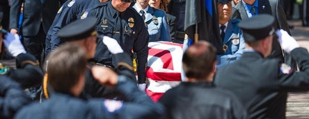 The casket of Phoenix Police Officer David Glasser is taken into Christ's Church of the Valley in Peoria Thursday, May 26, 2016, for his funeral service. Glasser died May 19, a day after he was wounded when shot by a burglary suspect who then was fatally shot by police. (Tom Tingle/The Arizona Republic via AP)  MARICOPA COUNTY OUT; MAGS OUT; NO SALES; MANDATORY CREDIT   MBO