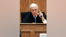 FILE - In this June 23, 2005 file photo, Neshoba County circuit judge Marcus Gordon, explains to reporters his considerations in sentencing Edgar Ray Killen to 20-year terms on each of three counts of manslaughter for the 1964 deaths of three civil rights workers in his Philadelphia, Miss., courtroom. Gordon died Thursday, May 26, 2016 at St. Dominic Hospital in Jackson, Miss. He was 84. Gordon sentenced Edgar Ray Killen to 60 years in prison after a mixed-race jury convicted the reputed former Ku Klux Klan leader of manslaughter in the 1964 kidnap-slaying of three civil rights workers in Neshoba County. (AP Photo/Rogelio V. Solis, File)