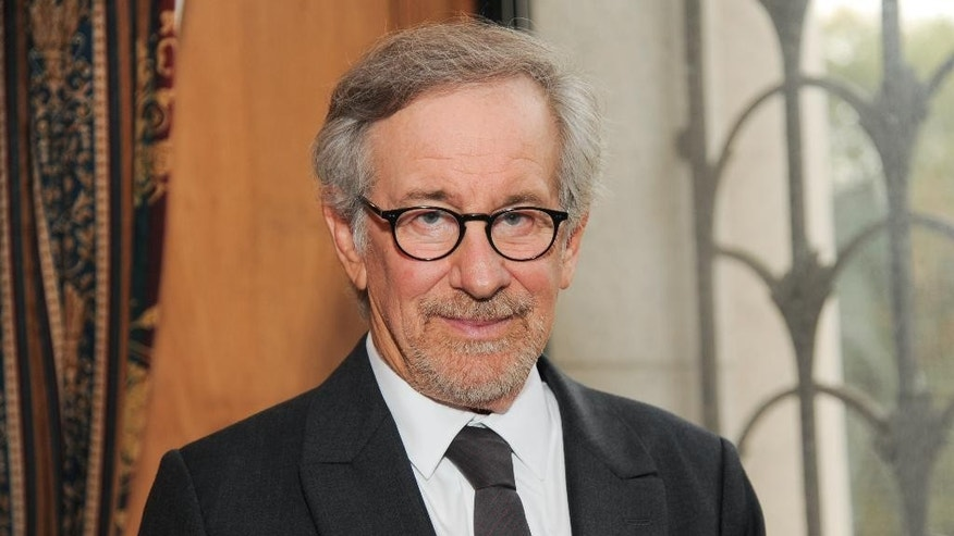 FILE - In this Oct. 3, 2013 file photo, filmmaker Steven Spielberg poses at the Museum of Natural History before the Ambassadors For Humanity Gala in New York. Spielberg is scheduled to deliver the commencement speech at Harvard University. The three-time Academy Award winner will address graduates at a ceremony Thursday afternoon, May 26, 2016.  (Photo by Evan Agostini/Invision/AP, File)