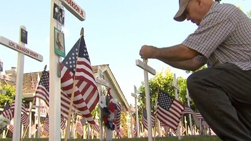 Dan Joseph remembers those from Central California who were killed in Afghanistan and Iraq with front yard Memorial Day display. (Fox40)