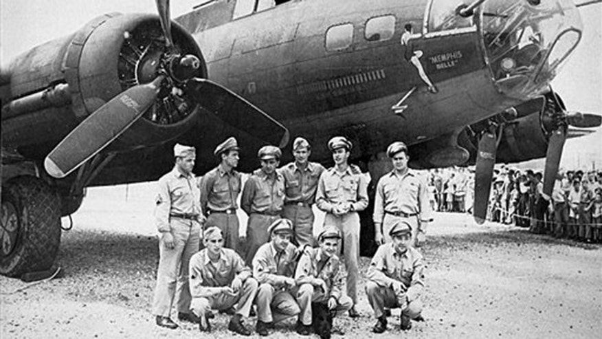 The crew of the Memphis Belle, a Flying Fortress B-17F, poses in front of their plane in Asheville, N.C.