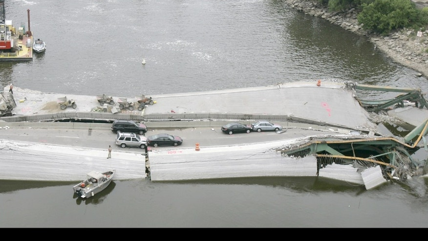 Vehicles are strewn among the wreckage of the Interstate 35W bridge in August 2007.